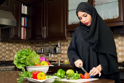 Arabian woman preparing salad in the kitchen